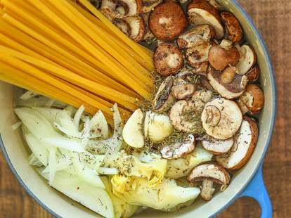 Raw pasta ingredients in pot