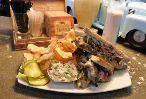 Plate with brisket sandwich and potato chips