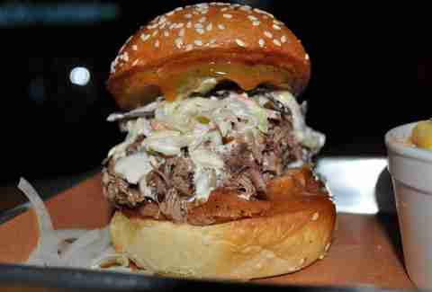Brioche burger stuffed with pulled pork and slaw