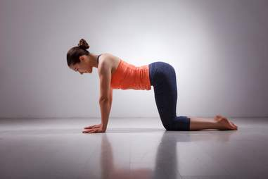 a woman doing yoga in an empty room healthy morning exercise routines