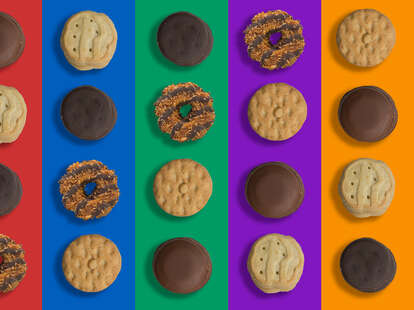 Assorted girl scout cookies on colorful background