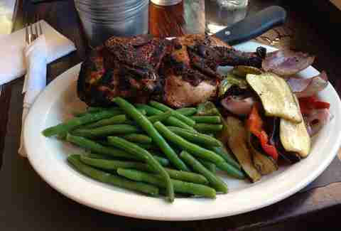 BBQ chicken, green beans, and grilled veggies on a plate