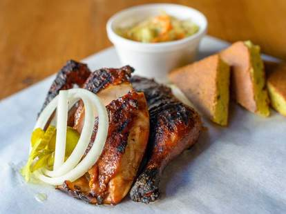 Barbecue chicken with corn bread on wax paper