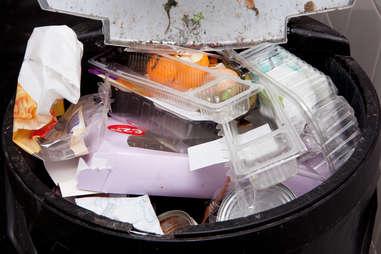 Trash bin filled with garbage
