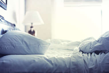 Blue sheets on bed