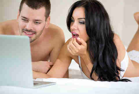 Couple watching porn together in bed