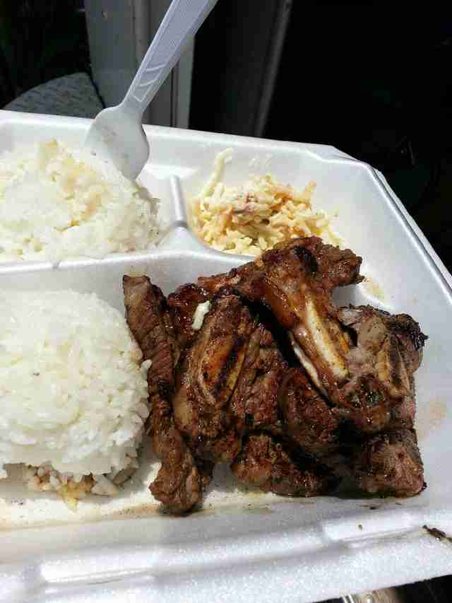 Ribs with rice in styrofoam container