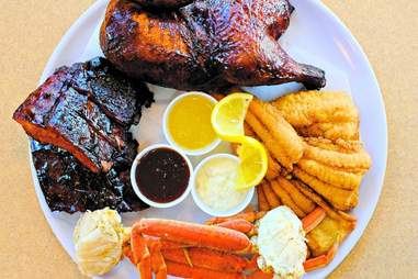 Plate with BBQ, crab legs, and fried chicken