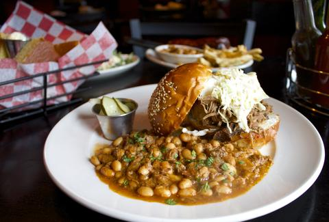 Maxie's Barbecue pork sandwich close up with beans