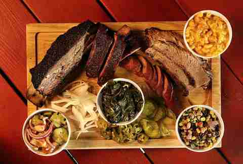 barbecue platter with onions, collard greens, cowboy caviar and mac and cheese