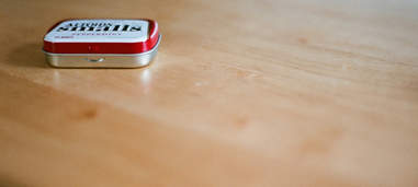Container of small Altoids on table