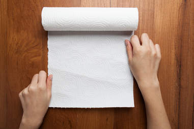 Person pulling paper towel roll