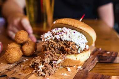 Torn brisket burger with meat overflowing