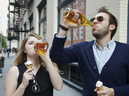 young people drinking 40s and eating ice cream outside public drinking beer
