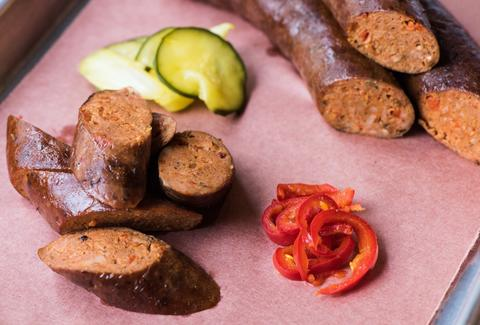 Sliced pieces of sausage and pickled cucumbers