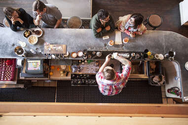 overhead shot of bartender at clyde common