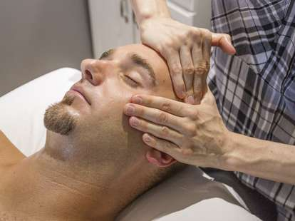 Man getting face massaged at Scottsdale spa