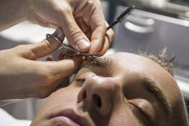 Man getting eyebrows clipped at Scottsdale spa