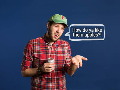 Hipster in plaid shirt wearing Boston Red Sox cap with speech bubble