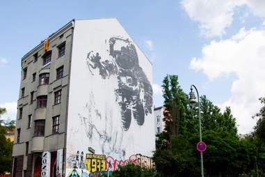 astronaut cosmonaut street art in berlin, germany
