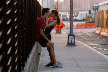 Couple kissing on street
