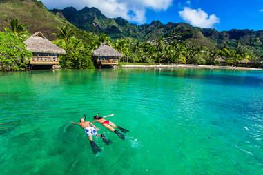 couple snorkeling in Tahiti