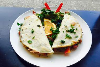 soft tortilla tacos with greens from Esto's Garage