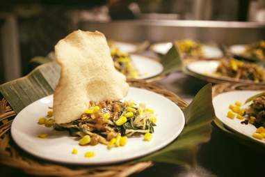 plates with corn and vegetables at Komodo Kitchen