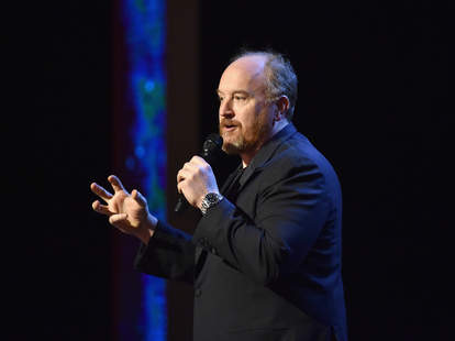 Comedian Louis C.K. performs on stage