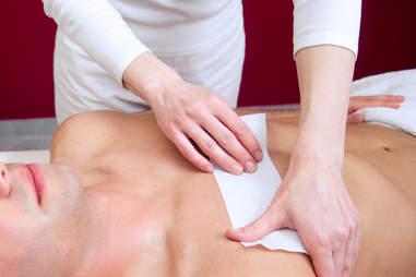 man getting waxed, man chest wax