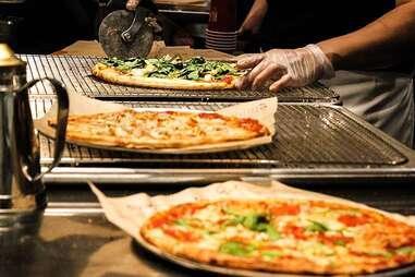 slicing a blaze pizza