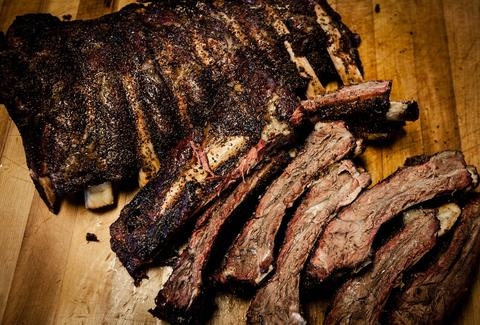 smoked beef ribs at Slows Bar B Q