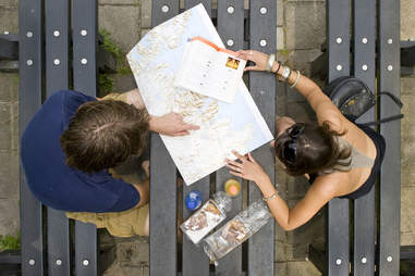 man and woman looking at a map planning a trip