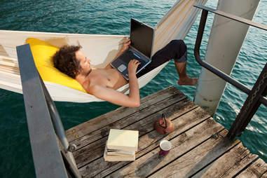 man on a hammock working