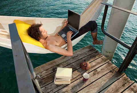 man on a hammock working