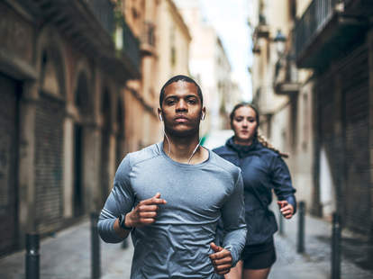 Runners exercising with ear buds Spotify