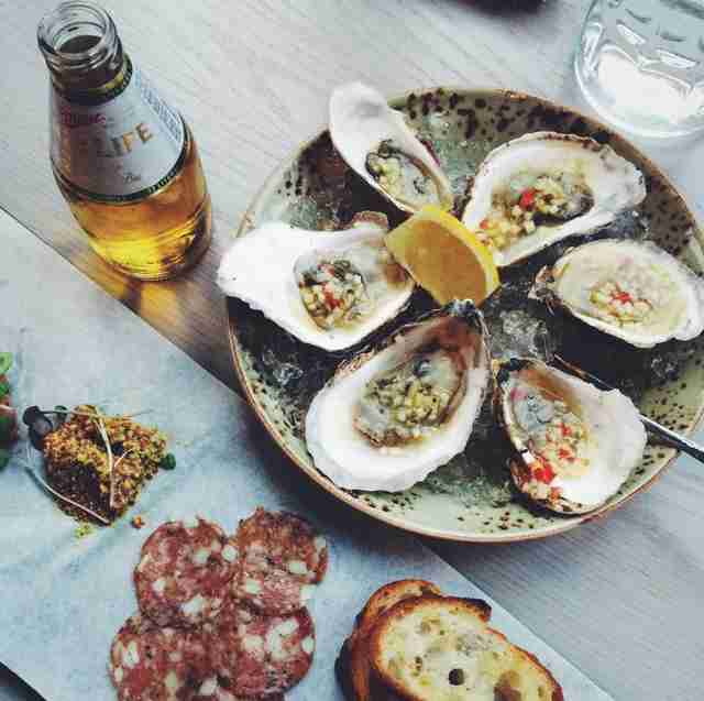 oysters beer and charcuterie at tavern road in boston
