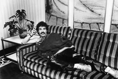 John Oates lounges on sofa in England