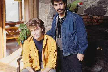 Daryl Hall and John Oates pose with parrots in upstate New York