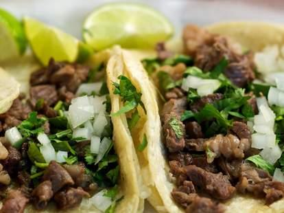 taqueria la veracruzana carne asada tacos with tortilla wrap cilantro onions