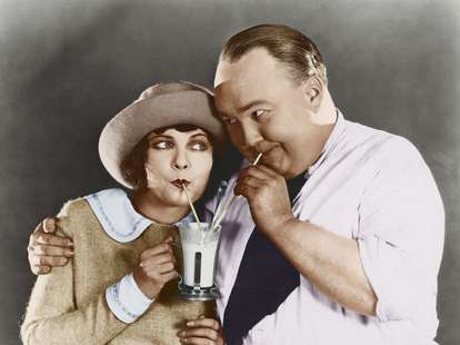 old fashioned photo a couple sharing a milkshake dating behaviors to reinstate