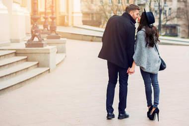 a stylish couple walking around city on a date