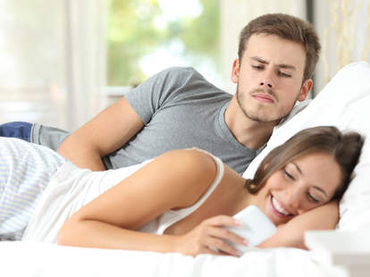 jealousy couple woman texting in bed