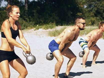 kettlebell swings on the beach