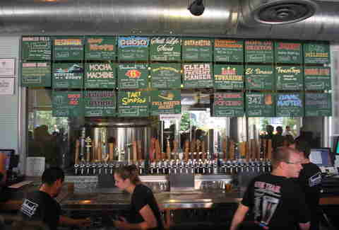 Bartenders and menu at Beachwood BBQ Brewing