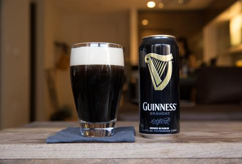 guinness beer can and pint glass