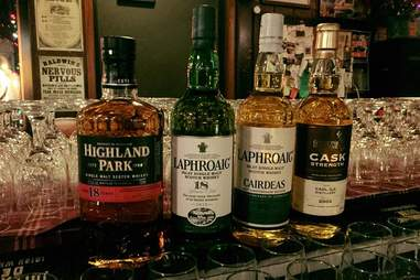 whiskey on display at merlin's rest twin cities msp