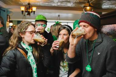drinkers at the liffey on st. patrick's day