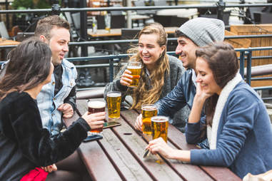group of friends drinking beer outside hygge