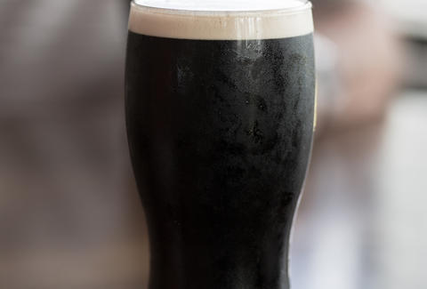 a pint glass of guinness